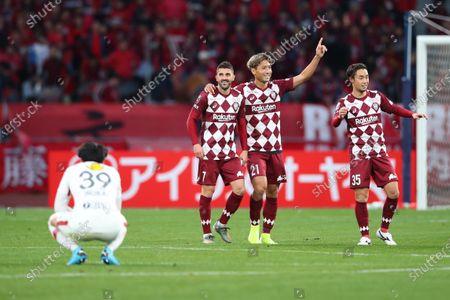 David Villa, Junya Tanaka and Takuya Yasui of Vissel Kobe celebrate during the match