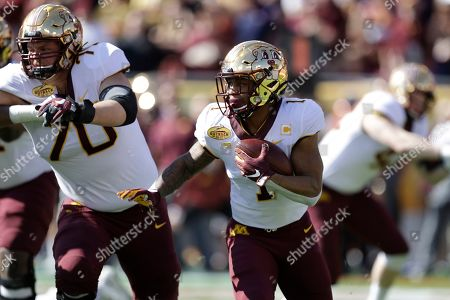 Minnesota running back Rodney Smith (1) follows a block by offensive lineman Sam Schlueter (70) during the first half of the Outback Bowl NCAA college football game against Auburn, in Tampa, Fla