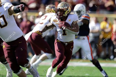 Minnesota running back Rodney Smith (1) runs against Auburn during the first half of the Outback Bowl NCAA college football game, in Tampa, Fla
