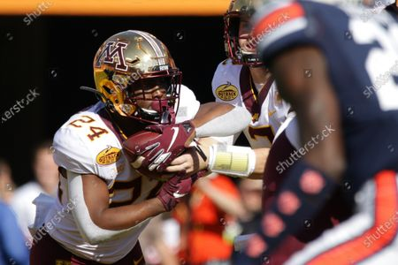 Minnesota Golden Gophers running back Mo Ibrahim (24) runs with the ball in the first quarter during the Outback Bowl NCAA football game between the Minnesota Gophers and the Auburn Tigers held at Raymond James Stadium in Tampa, Florida. Andrew J