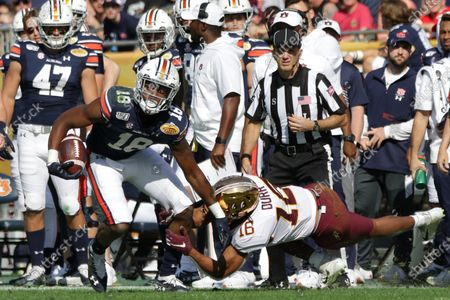 Stock Photo of Auburn Tigers wide receiver Seth Williams (18) runs with the ball against Minnesota Golden Gophers defensive back Coney Durr (16) during the Outback Bowl NCAA football game between the Minnesota Gophers and the Auburn Tigers held at Raymond James Stadium in Tampa, Florida. Andrew J