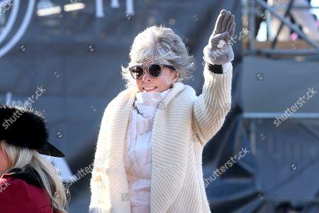 Grand Marshal Rita Moreno waves to the crowd during the 131st Rose Parade in Pasadena, Calif