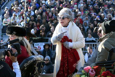 Grand Marshal Rita Moreno motions to a television at the 131st Rose Parade in Pasadena, Calif