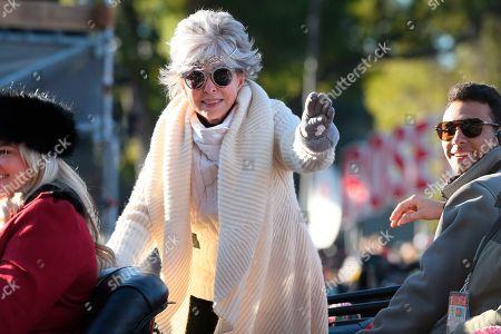 Grand Marshal Rita Moreno waves to the crowd at the 131st Rose Parade in Pasadena, Calif