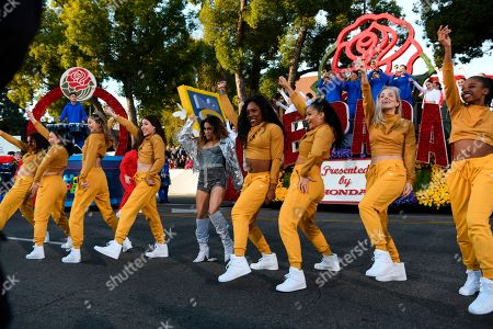 Singer Ally Brooke, center, performs at the 131st Rose Parade in Pasadena, Calif