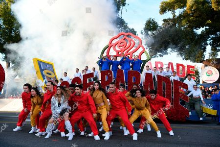 Singer Ally Brooke, fourth from left, leads a performance at the 131st Rose Parade in Pasadena, Calif