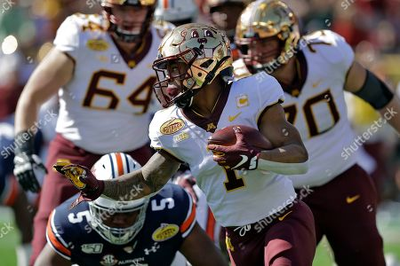 Rodney Smith, Derrick Brown. Minnesota running back Rodney Smith (1) runs past Auburn defensive tackle Derrick Brown (5) during the first half of the Outback Bowl NCAA college football game, in Tampa, Fla