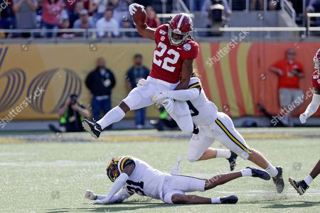 Najee Harris, Vincent Gray, DeMarcco Hellams. Alabama running back Najee Harris (22) gains yardage as he tries to get past Michigan defensive back Vincent Gray (31) and defensive back DeMarcco Hellams, right, during the first half of the Citrus Bowl NCAA college football game, in Orlando, Fla