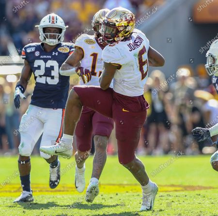 Minnesota's Tyler Johnson #6 lands on his feet after jumping up to catch a long pass during the Outback Bowl football game between the Minnesota Golden Gophers and the Auburn Tigers at Raymond James Stadium in Tampa, FL