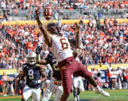 Minnesota's Tyler Johnson #6 stretches to catch the ball for a touchdown during the Outback Bowl football game between the Minnesota Golden Gophers and the Auburn Tigers at Raymond James Stadium in Tampa, FL