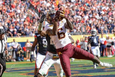 Minnesota's Tyler Johnson #5 catches a pass in the end zone for a TD during the Outback Bowl football game between the Minnesota Golden Gophers and the Auburn Tigers at Raymond James Stadium in Tampa, FL