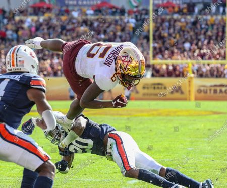 Minnesota's Tyler Johnson #6 flips in the air near the goal line during the Outback Bowl football game between the Minnesota Golden Gophers and the Auburn Tigers at Raymond James Stadium in Tampa, FL
