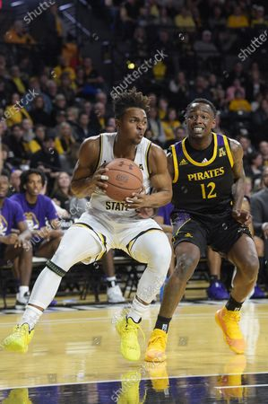 Wichita State Shockers guard Tyson Etienne (1) handles the ball against pressure by East Carolina Pirates guard Tremont Robinson-White (12) during the NCAA Basketball Game between the East Carolina Pirates and the Wichita State Shockers at Charles Koch Arena in Wichita,Kansas