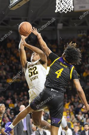 Wichita State Shockers guard Grant Sherfield (52) shoots the ball over East Carolina Pirates forward Brandon Suggs (4) during the NCAA Basketball Game between the East Carolina Pirates and the Wichita State Shockers at Charles Koch Arena in Wichita,Kansas