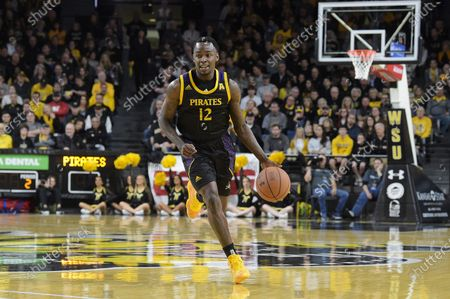 Stock Photo of East Carolina Pirates guard Tremont Robinson-White (12) brings the ball up court during the NCAA Basketball Game between the East Carolina Pirates and the Wichita State Shockers at Charles Koch Arena in Wichita,Kansas