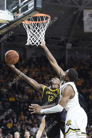 East Carolina Pirates guard Tremont Robinson-White (12) gets to the rim for an easy basket during the NCAA Basketball Game between the East Carolina Pirates and the Wichita State Shockers at Charles Koch Arena in Wichita,Kansas