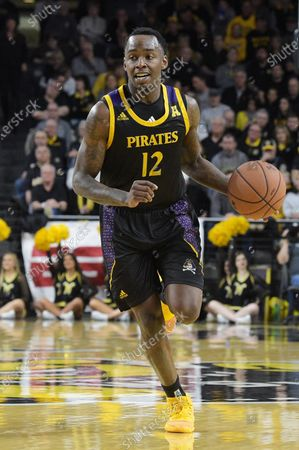 East Carolina Pirates guard Tremont Robinson-White (12) handles the ball during the NCAA Basketball Game between the East Carolina Pirates and the Wichita State Shockers at Charles Koch Arena in Wichita,Kansas