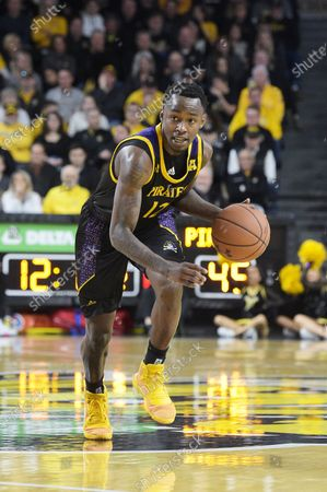 East Carolina Pirates guard Tremont Robinson-White (12) brings the ball up court during the NCAA Basketball Game between the East Carolina Pirates and the Wichita State Shockers at Charles Koch Arena in Wichita,Kansas