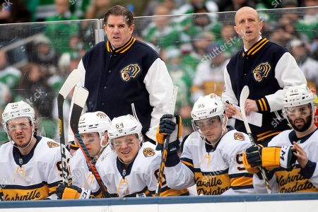 Nashville Predators head coach Peter Laviolette, top right, watches play during the third period of the NHL Winter Classic hockey game against the Dallas Stars at the Cotton Bowl, in Dallas. Dallas won 4-2