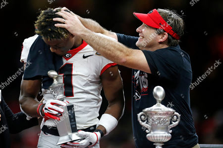Georgia head coach Kirby Smart rubs the hair fo wide receiver George Pickens as he is presented with the MVP of the game trophy, after the Sugar Bowl NCAA college football game against Baylor in New Orleans, . Georgia won 26-14