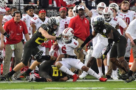 Pasadena, CA.Wisconsin Badgers wide receiver Danny Davis III #6 runs in action in the third quarter during the 106th Rose Bowl College football game between the Oregon Ducks and the Wisconsin Badgers at the Rose Bowl on , in Pasadena, California..The Oregon Ducks defeat the Wisconsin Badgers 28-27