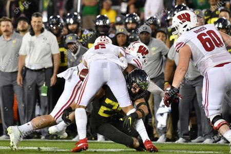 Pasadena, CA.Wisconsin Badgers wide receiver Danny Davis III #6 runs and fumbles the ball as he is hit by Oregon Ducks safety Brady Breeze #25 in action in the fourth quarter during the 106th Rose Bowl College football game between the Oregon Ducks and the Wisconsin Badgers at the Rose Bowl on , in Pasadena, California..The Oregon Ducks defeat the Wisconsin Badgers 28-27