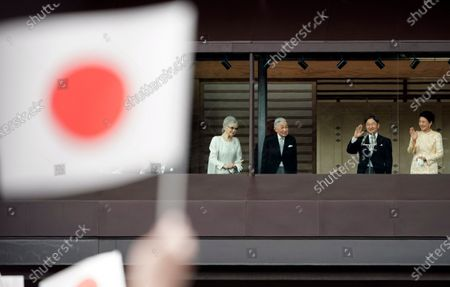 (L-R) Japan's former Empress Michiko, former Emperor Akihito, his son and current Japanese Emperor Naruhito, and Empress Masako greet well-wishers through a bullet-proof glass from a balcony during their New Year's public appearance at the Imperial Palace in central Tokyo, Japan, 02 January 2020. It was Naruhito's first New Year address to the nation since his ascension to the Chrysanthemum Throne.