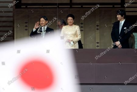 Japanese Emperor Naruhito (L), Empress Masako (C) and Crown Prince Akishino (R) greet well-wishers through a bullet-proof glass from a balcony during their New Year's public appearance at the Imperial Palace in central Tokyo, Japan, 02 January 2020. It was Naruhito's first New Year address to the nation since his ascension to the Chrysanthemum Throne.