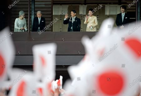 (L-R) Japan's former Empress Michiko, former Emperor Akihito, his son and current Japanese Emperor Naruhito, Empress Masako and Crown Prince Akishino greet well-wishers through a bullet-proof glass from a balcony during their New Year's public appearance at the Imperial Palace in central Tokyo, Japan, 02 January 2020. It was Naruhito's first New Year address to the nation since his ascension to the Chrysanthemum Throne.