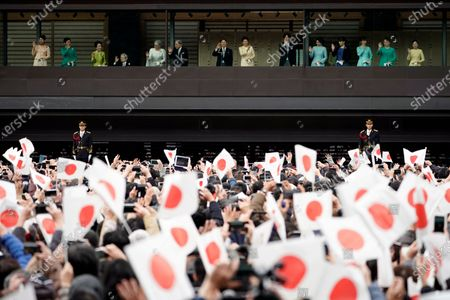 Japan's former Empress Michiko (5-L), former Emperor Akihito (6-L), his son and current Japanese Emperor Naruhito (C-L), Empress Masako (C-R) and Crown Prince Akishino (6-R) greet well-wishers through a bullet-proof glass from a balcony during their New Year's public appearance at the Imperial Palace in central Tokyo, Japan, 02 January 2020. It was Naruhito's first New Year address to the nation since his ascension to the Chrysanthemum Throne.