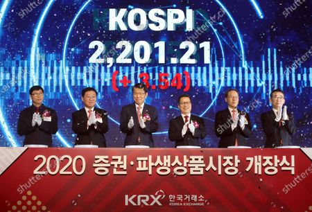 Jung Ji-won (3-R), chief executive of the Korea Exchange, Financial Services Commission Chairman Eun Sung-soo (3-L) and others attend a 2020 stock market opening ceremony in Seoul, South Korea, 02 January 2020.
