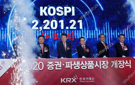 Jung Ji-won (3-R), chief executive of the Korea Exchange, Financial Services Commission Chairman Eun Sung-soo (3-L) and others attend a 2020 stock market opening ceremony in Seoul, South Korea, 02 January 2020. The benchmark South Korea Composite Stock Price Index (KOSPI) start at 2,201.21.