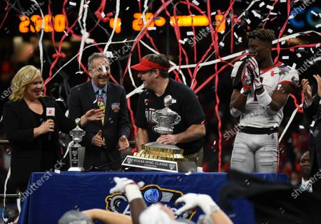 Georgia Bulldogs head coach KIRBY SMART accepts the Allstate Sugar Bowl trophy with Georgia Bulldogs wide receiver George Pickens (1) next to him after the NCAA Football game action between the Georgia Bulldogs and the Baylor Bears at Mercedes-Benz Superdome in New Orleans, LA