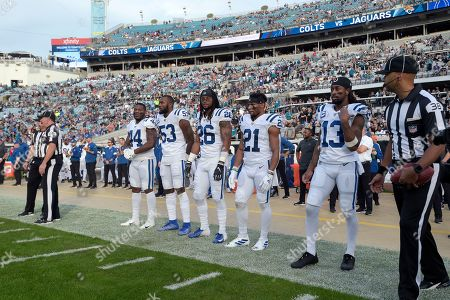 Indianapolis Colts linebacker Zaire Franklin (44), linebacker Darius Leonard (53), safety Clayton Geathers (26), running back Nyheim Hines (21) and wide receiver T.Y. Hilton (13) wait to walk to midfield for the coin toss before an NFL football game against the Jacksonville Jaguars, in Jacksonville, Fla