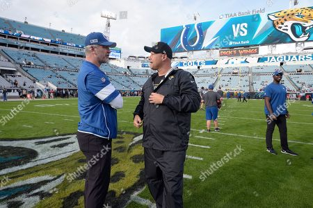 Jacksonville Jaguars quarterbacks coach Scott Milanovich, right, and Indianapolis Colts head coach Frank Reich chat on the field before an NFL football game, in Jacksonville, Fla