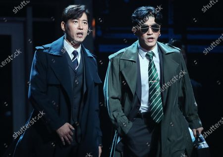 Stock Image of South Korean actors Yoo Joon-sang (L) and Park Min-seong perform during a press preview of a musical based on 'A Better Tomorrow,' a 1986 Hong Kong action film directed by John Woo, at an arts center in Seoul, South Korea, 02 January 2020.
