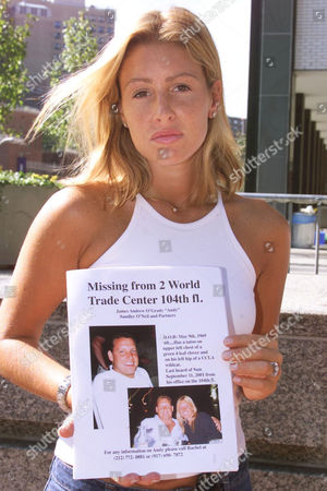 Rachel Uchitel holds a missing notice of her fiancee Andy O'Grady who was working on the 104th floor of World Trade Centre Tower One and has been missing ever since