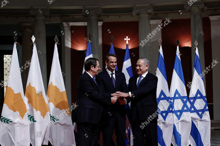 Greece's Prime Minister Kyriakos Mitsotakis, center, Cypriot President Nicos Anastasiadis, left, and Israeli Prime Minister Benjamin Netanyahu pose for a photograph ahead of a signing ceremony in Athens, . The leaders of Greece, Israel and Cyprus met in Athens Thursday to sign a deal aiming to build a key undersea pipeline, named EastMed, designed to carry gas from new rich offshore deposits in the southeastern Mediterranean to continental Europe