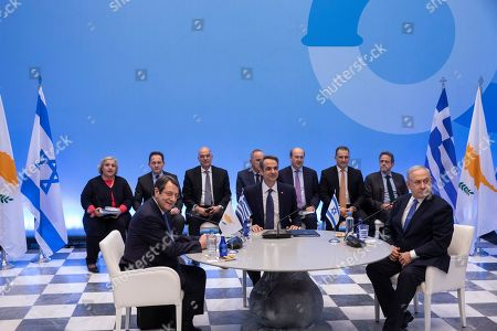 Israeli Prime Minister Benjamin Netanyahu, right, Greece's Prime Minister Kyriakos Mitsotakis, center, and Cypriot President Nicos Anastasiadis attend a meeting ahead of a signing ceremony, in Athens, . The leaders of Greece, Israel and Cyprus met in Athens Thursday to sign a deal aiming to build a key undersea pipeline, named EastMed, designed to carry gas from new rich offshore deposits in the southeastern Mediterranean to continental Europe