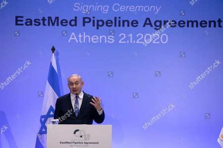 Israeli Prime Minister Benjamin Netanyahu speaks during a joint news briefing with Greece's Prime Minister Kyriakos Mitsotakis, and Cypriot President Nicos Anastasiadis, in Athens, . The leaders of Greece, Israel and Cyprus met in Athens Thursday to sign a deal aiming to build a key undersea pipeline, named EastMed, designed to carry gas from new rich offshore deposits in the southeastern Mediterranean to continental Europe