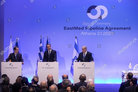 Israeli Prime Minister Benjamin Netanyahu, right, Greece's Prime Minister Kyriakos Mitsotakis, center, and Cypriot President Nicos Anastasiadis attend a joint news briefing, in Athens, . The leaders of Greece, Israel and Cyprus met in Athens Thursday to sign a deal aiming to build a key undersea pipeline, named EastMed, designed to carry gas from new rich offshore deposits in the southeastern Mediterranean to continental Europe