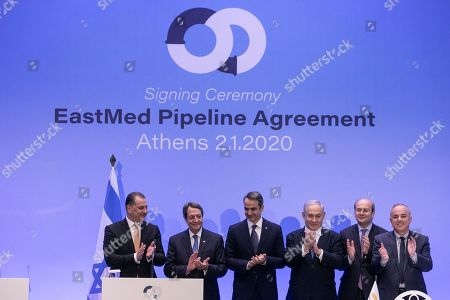 From left, Cypriot Energy Minister Georgios Lakkotrypis, Cypriot President Nicos Anastasiadis, Greece's Prime Minister Kyriakos Mitsotakis, Israeli Prime Minister Benjamin Netanyahu, Greek Energy Minister Kostis Hatzidakis, and Israel's Minister of Energy and Water Yuval Steinitz applaud following a signing ceremony, in Athens, . The leaders of Greece, Israel and Cyprus met in Athens Thursday to sign a deal aiming to build a key undersea pipeline, named EastMed, designed to carry gas from new rich offshore deposits in the southeastern Mediterranean to continental Europe