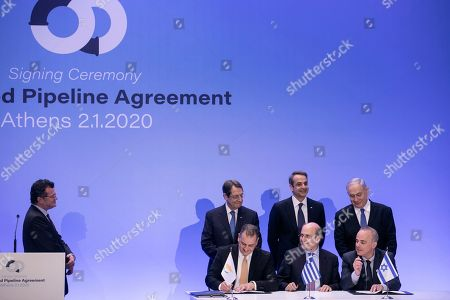 Cypriot Energy Minister Georgios Lakkotrypis, front left, Greek Energy Minister Kostis Hatzidakis, front center, and Israel's Minister of Energy and Water Yuval Steinitz sign an agreement as Greece's Prime Minister Kyriakos Mitsotakis, rear center, Cypriot President Nicos Anastasiadis, rear left, and Israeli Prime Minister Benjamin Netanyahu look, in Athens, . The leaders of Greece, Israel and Cyprus met in Athens Thursday to sign a deal aiming to build a key undersea pipeline, named EastMed, designed to carry gas from new rich offshore deposits in the southeastern Mediterranean to continental Europe