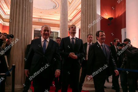 Stock Picture of Israeli Prime Minister Benjamin Netanyahu, left, Greece's Prime Minister Kyriakos Mitsotakis, center, and Cypriot President Nicos Anastasiadis arrive for a signing ceremony at Zappeio hall, in Athens, . The leaders of Greece, Israel and Cyprus met in Athens Thursday to sign a deal aiming to build a key undersea pipeline, named EastMed, designed to carry gas from new rich offshore deposits in the southeastern Mediterranean to continental Europe