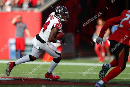 Atlanta Falcons wide receiver Justin Hardy (14) runs with the ball after a catch against the Tampa Bay Buccaneers during an NFL football game, in Tampa, Fla. The Falcons won the game 28-22 in overtime