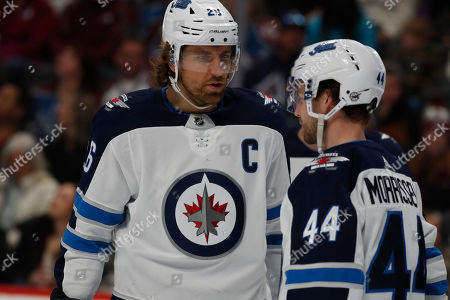 R m. Winnipeg Jets right wing Blake Wheeler (26) confers with Winnipeg Jets defenseman Josh Morrissey (44) in the first period of an NHL hockey game, in Denver