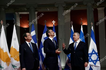Stock Photo of Greek Prime Minister Kyriakos Mitsotakis (C) talks with President of Cyprus Nicos Anastasiadis (L) and Israeli Prime Minister Benjamin Netanyahu (R) during a meeting prior to the signing of the EastMed agreement in Athens, Greece, 02 January 2020. An intergovernmental agreement on the EastMed natural gas pipeline will be signed by Greece, Cyprus and Israel, containing provisions on measures for the protection and security of the pipeline.