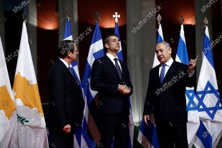 Greek Prime Minister Kyriakos Mitsotakis (C) talks with President of Cyprus Nicos Anastasiadis (L) and Israeli Prime Minister Benjamin Netanyahu (R) during a meeting prior to the signing of the EastMed agreement in Athens, Greece, 02 January 2020. An intergovernmental agreement on the EastMed natural gas pipeline will be signed by Greece, Cyprus and Israel, containing provisions on measures for the protection and security of the pipeline.