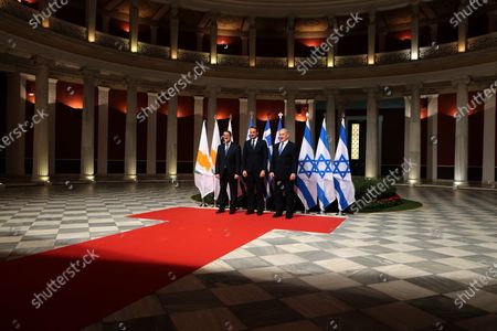 Greek Prime Minister Kyriakos Mitsotakis (C) welcomes President of Cyprus Nicos Anastasiadis (L) and Israeli Prime Minister Benjamin Netanyahu (R) during a meeting prior to the signing of the EastMed agreement in Athens, Greece, 02 January 2020. An intergovernmental agreement on the EastMed natural gas pipeline will be signed by Greece, Cyprus and Israel, containing provisions on measures for the protection and security of the pipeline.