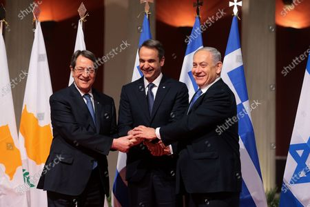 Stock Image of Greek Prime Minister Kyriakos Mitsotakis (C), President of Cyprus Nicos Anastasiadis (L) and Israeli Prime Minister Benjamin Netanyahu (R) join hands, during a meeting prior to the signing of the EastMed agreement in Athens, Greece, 02 January 2020. An intergovernmental agreement on the EastMed natural gas pipeline will be signed by Greece, Cyprus and Israel, containing provisions on measures for the protection and security of the pipeline.